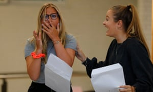 Ella Rosenblatt, left, who achieved 2 A*s and one A grade, is congratulated by Grace Leaitherland after opening her A-level results at Withington girls' school in Manchester