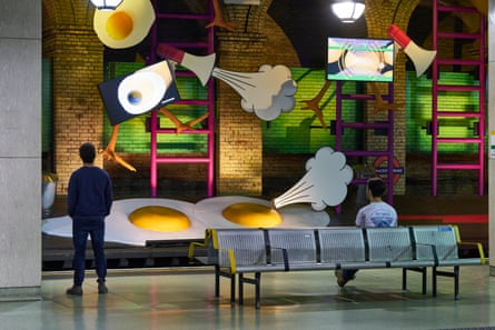 Tube travellers contemplate Heather Phillipson's installation.