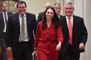 Ardern arrives at a Wellington press conference flanked by MPs Kelvin Davis and Grant Robertson on 19 October 2017, after incumbent Bill English conceded