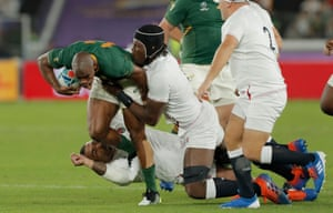 South Africa's Makazole Mapimpi is tackled in the opening moments by Kyle Sinckler and Maro Itoje.