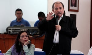 Nicaragua's President Daniel Ortega speaks, as Vice-President Rosario Murillo listens during first round of dialogue after a series of violent protests against his government in Managua on Wednesday.