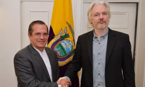WikiLeaks founder Julian Assange (R) with Ecuadorian foreign minister Ricardo Patino after a press conference in the Ecuadorian embassy in 2014.