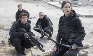 Crowded market … Jennifer Lawrence as Katniss Everdeen and Liam Hemsworth, foreground, as Gale Hawthorne in The Hunger Games: Mockingjay - Part 2.