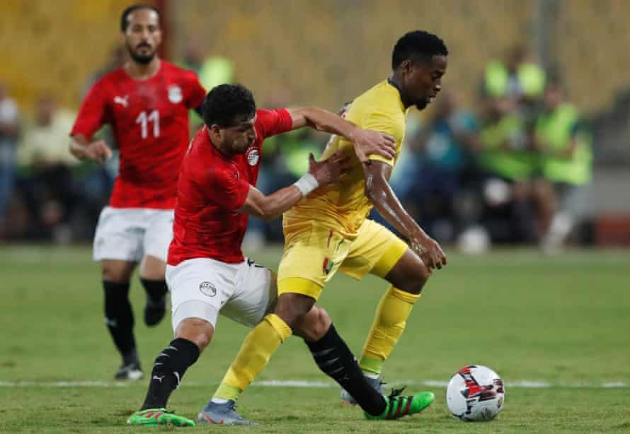 Guinea's Amadou Diawara tries to get away from Egypt's Tarek Hamed in a friendly last Sunday.