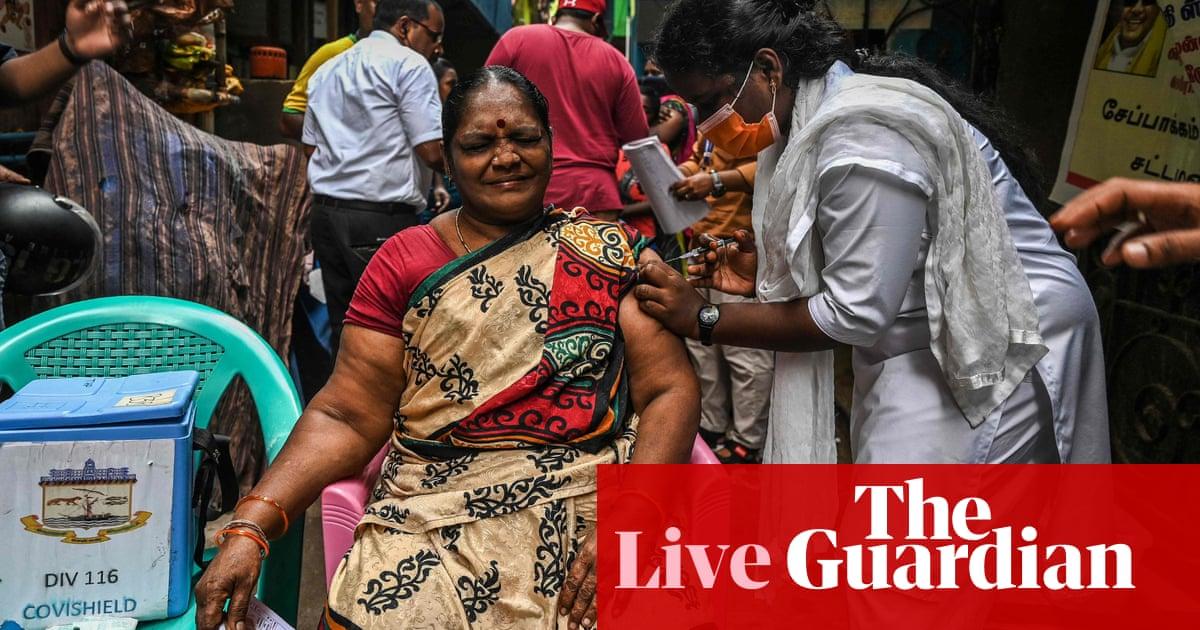 Coronavirus live: UK not seeing 'unsustainable pressure' on health service; India administers billionth jab