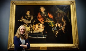 Lucy Bamford, senior curator at the Derby Museum and Art Gallery, stands in front of Joseph Wright's masterpiece A Philosopher Lecturing on the Orrery.