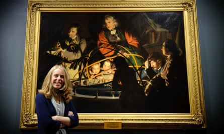 Lucy Bamford in front of Joseph Wright of Derby's A Philosopher Lecturing on the Orrery