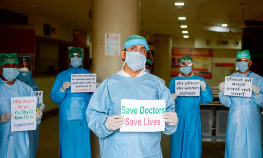 Doctors and medical staff at Narayan Swaroop Hospital in Allahabad, India, protest against assaults on medical staff