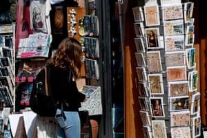 A tourist looks at a souvenirs