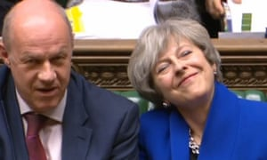 The prime minister smiles as she sits alongside Damian Green who she sacked as first secretary of state.