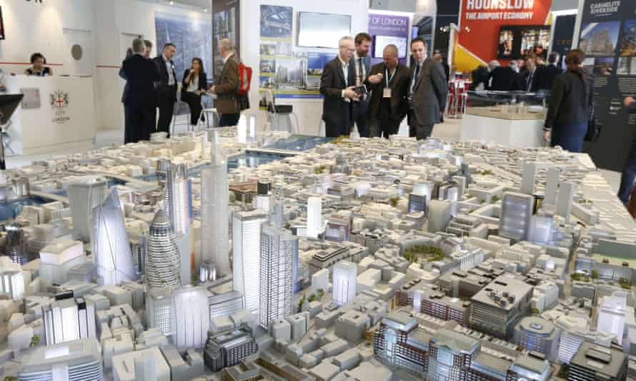 People look at a scale model of the city of London at the 2014 Mipim conference in Cannes.