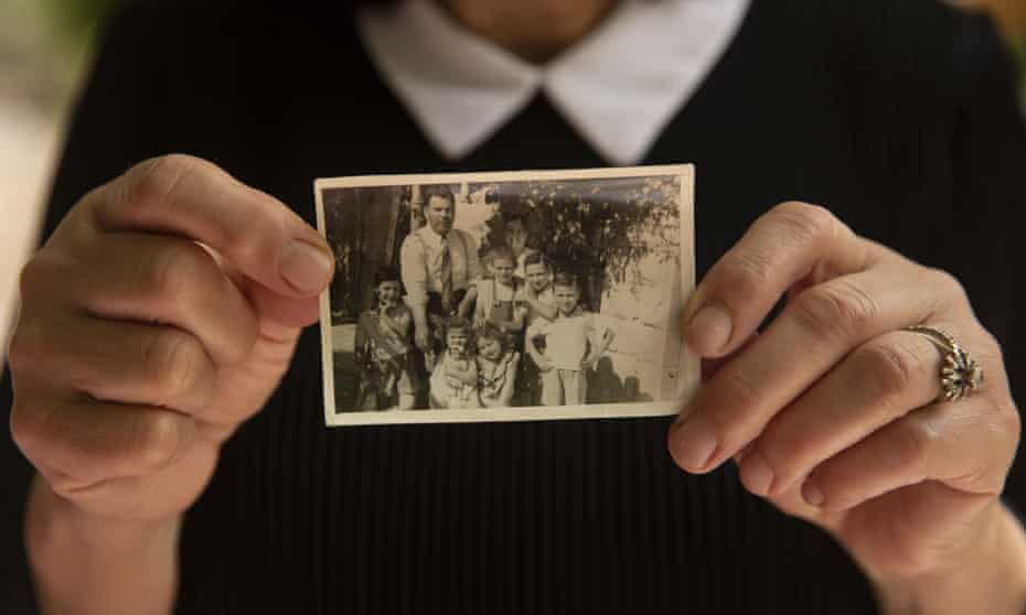 A Palestinian woman holds a photo of her family in 1956 after they moved into their home in the Sheikh Jarrah neighbourhood of east Jerusalem.