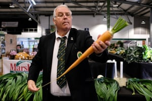 A judge inspects a carrot