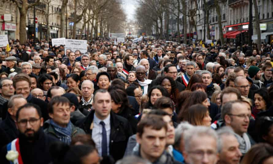 A huge crowd walks during a silent march in Paris, France, in commemoration of 85-year-old Jewish woman Mireille Knoll