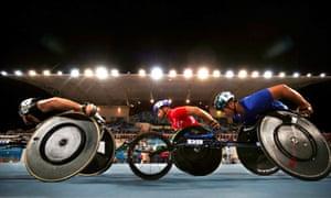 Dubai, United Arab EmiratesChina's Yunqiang Dai and Thailand's Putharet Khongrak in action during the Men's 5000m T54 Final at the 2019 World Para Athletics ChampionshipsAthletics.