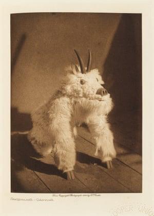 Táwihyilahl – a masked dancer of the Qáĥgyuĥl.