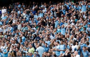 The Manchester City fans react during the match.