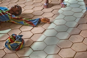A woman falls on the floor after a spiritual experience, Nigeria.