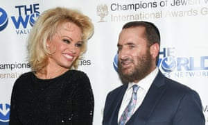 Pamela Anderson with Rabbi Shmuley Boteach. Anderson has appeared on the cover of Playboy 14 times, most recently in December.