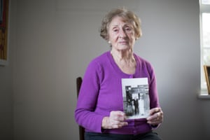 Susan Pollack, who the survived Bergen-Belsen camp, holds a photograph of herself with her parents, who both perished at the hands of the Nazis.