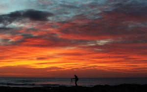 A photographer captures the sunrise in Whitley Bay, England