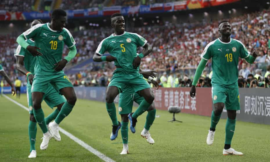 Senegal's Mbaye Niang, right, celebrates with his teammates after scoring their second goal against Poland.