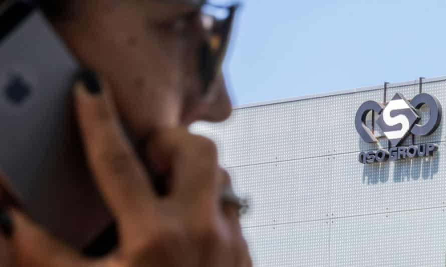 A woman uses her phone in front of the building housing the Israeli NSO group, in Herzliya, near Tel Aviv