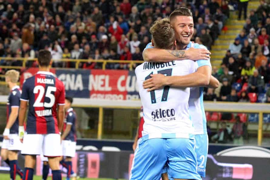 Sergej Milinkovic-Savic celebrates with his Ciro Immobile after opening the scoring for Lazio at Bologna.