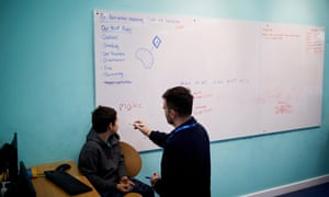 Brooklyn, 10, listens to a tutor at Explore Learning in Bradford