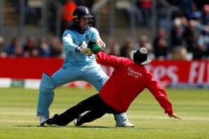 England's Jason Roy runs into umpire Joel Wilson.