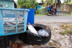 Freshly caught fish lie at the side of the road in Funafuti