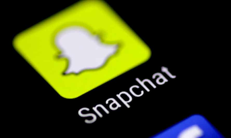 The Snapchat logo on a smartphone screen