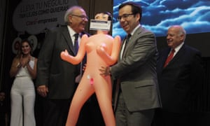 Chile's economy minister, Luis Felipe Céspedes, right, receiving a inflatable doll from President of the Association of Exporters of Manufactures (Asexma) Roberto Fantuzzi, left, in Santiago, Chile, on Tuesday.