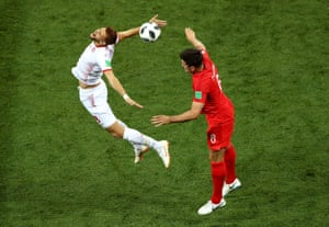 Tunisia's Fakhreddine Ben Youssef and England's Harry Maguire battle for the ball as the game gets under way.