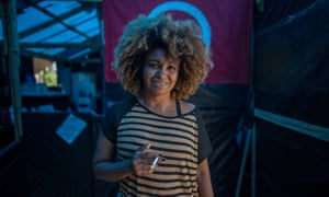 Ediane, 35, inside the camp