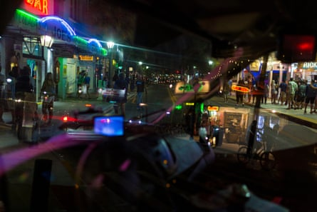 View from inside a local authority vehicle as Police shut down the access to automobile traffic on Duval Street to make more space for crowds to social distance.