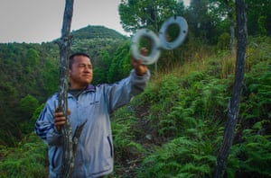 Farmer Tashi Wangdi sounds the alarm bell to ward off animals from his hazelnut trees. He has high hopes for a more secure future. With layout assistance from the Mountain Hazelnuts team, he's planted two acres of trees. 'I'm very encouraged so far,' he says. 'I see my barren land now becoming populated with trees.'