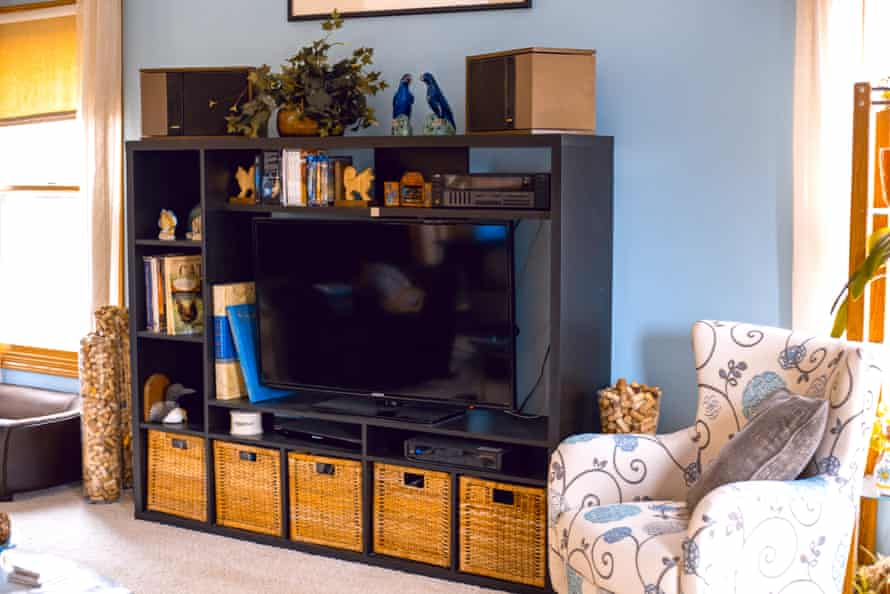 Living room scene with black entertainment center Living room scene with black entertainment center with wicker storage cubes.
