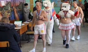 Members of a local winter swimming club visit a polling station in Barnaul.