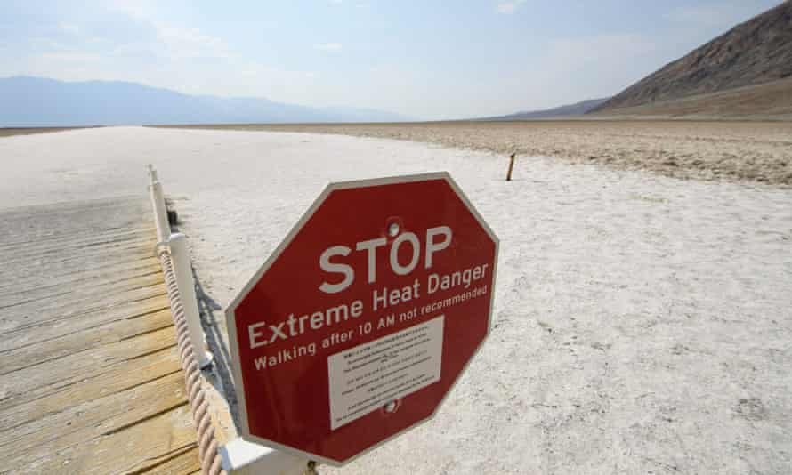 A sign warns of the danger of extreme heat in the salt flats of Death Valley National Park.