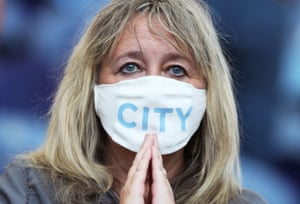 A Manchester City's supporter praying for her side to win their first Champions League title.
