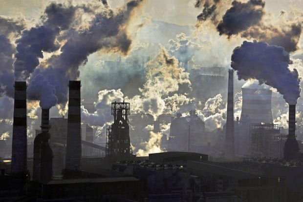 This handout photo taken on November 17, 2014 and released by Greenpeace on January 22, 2015 shows smoke billowing from smokestacks from iron and steel plants in Qian'an, Hebei province. The skies of China's notoriously smog-filled cities saw a marginal amelioration in 2014, according to figures released by Greenpeace on January 22, 2015, but pollution remained far above national and international standards.