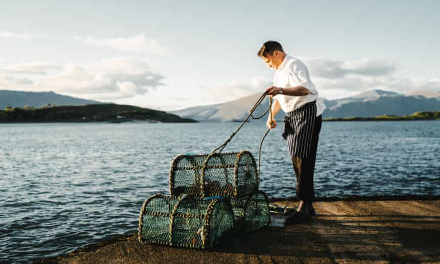 A fisherman with small round nets at Loch Linnhe