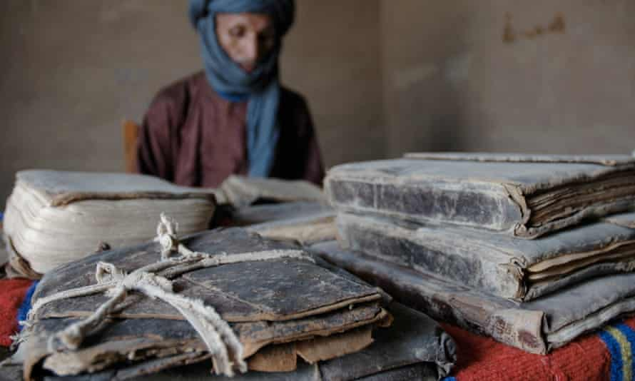 Fida Ag Mohamed in Timbuktu, with some of his family's ancient manuscripts dating back to the 1300s.