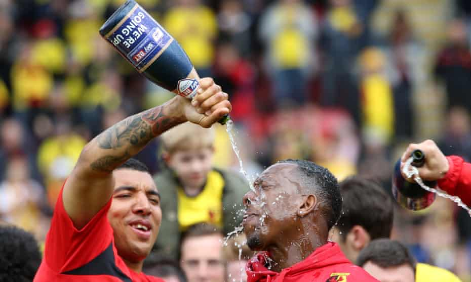 Deeney pours champagne over teammate Lloyd Doyley after Watford's promotion, 2015.