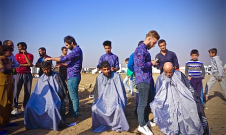 Four hairdressers from Erbil have travelled to the Hassanshama camp to shave the men there.