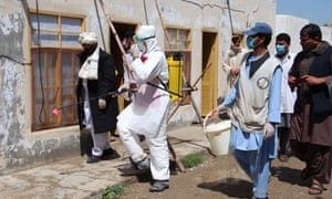 Afghan health workers spray disinfectants at public places in Helmand, Afghanistan, in April.