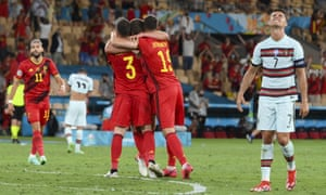 Portugal's Cristiano Ronaldo, right, reacts as Belgium players celebrate following the match.