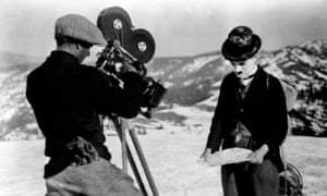 Charlie Chaplin and a cameraman in a scene from his comedy 'Alaska', September 30, 1924.