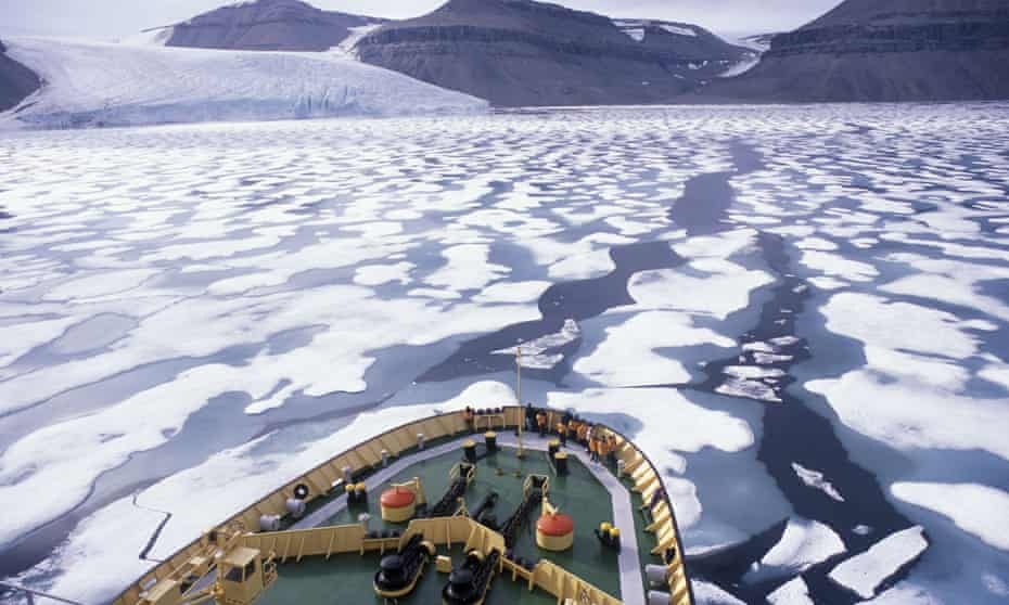 """View of ice and the Prince Leopold Island cliffs in the fog from the Russian Beaufort Sea icebreaker ship """"Kapitan Khlebnikov"""" on one of the Quark Expeditions voyages in August 2002."""